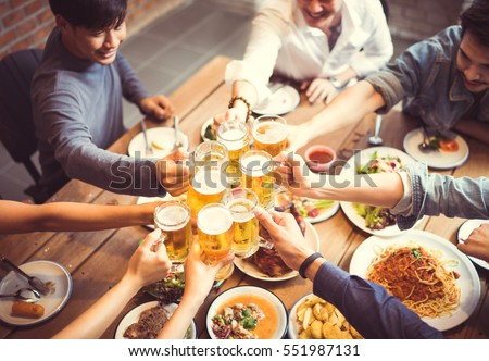 People in asian are celebrating the festival they clink glasses beer and dinner happy.top view