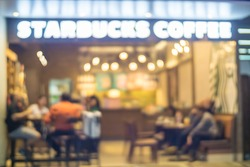 People in Coffee shop blur background with bokeh lights, vintage filter, blurred  of star buck cafeteria coffee