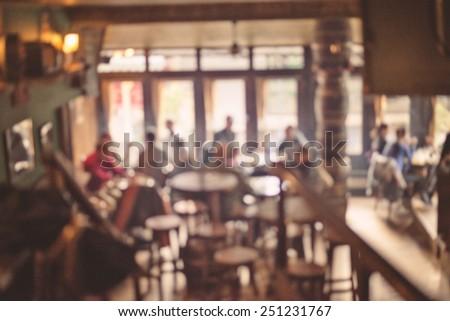 people in coffee shop blur...