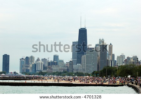 people in lake shore to view air show (cloudy day)