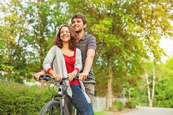 people in love - riding together on the same bicycle