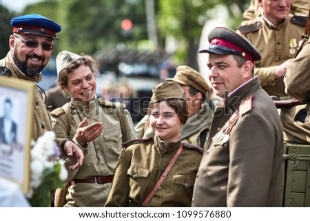 People in military uniform in honor of the Victory Day holiday. Military historical society, reconstruction of the appearance of fighters of the Second World War II. Rostov-on-Don. Russia 9.5.2018 #1099576880