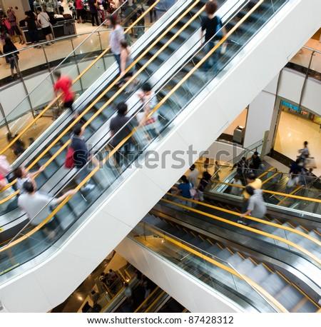 people in motion in escalators...