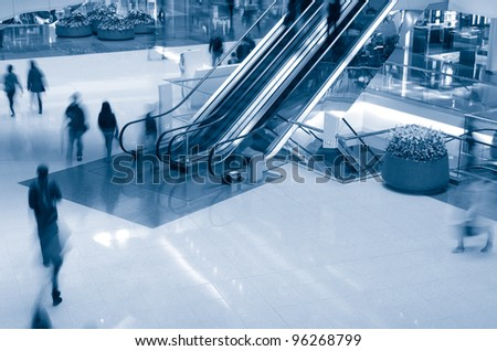 People in motion in escalators at the shopping mall