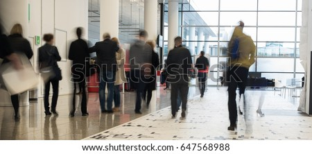 People in motion with motion blur #647568988