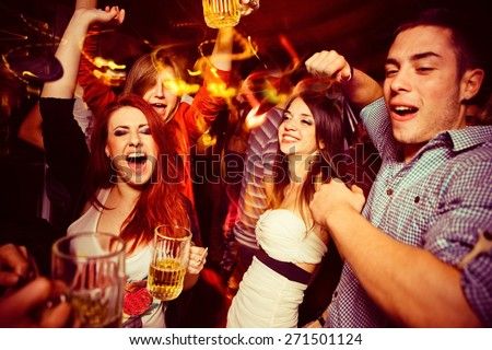 People in night club. Dancing, drinking and having fun