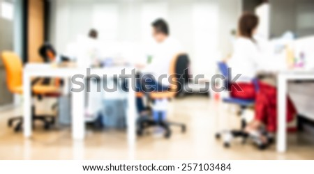 People in office organization blur background with bokeh.