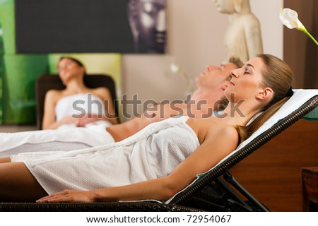 People in relaxation room after doing sports or sauna