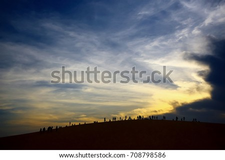 People in the desert at sunset #708798586