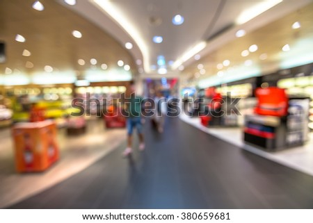 People in the duty free shop at the airport. Blur effect.