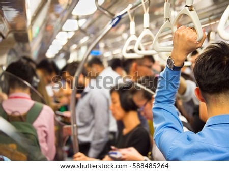 People inside the crowded metro train. Singapore
