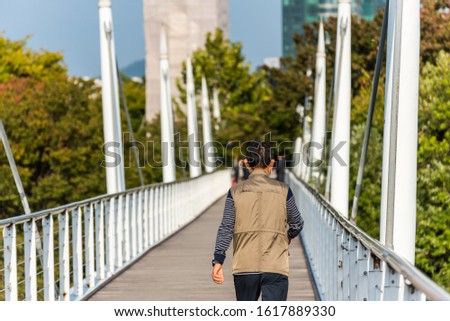 People jogging on the bridge  at the Seoul forest park in downtown of Seoul, in South Korea