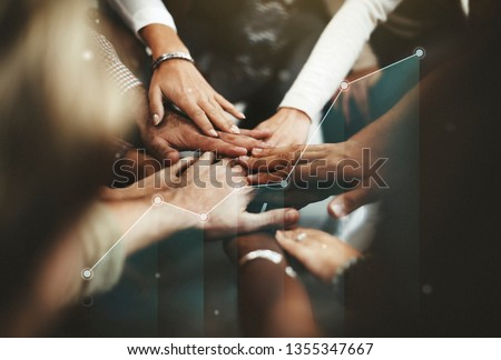 People joining hands in the middle