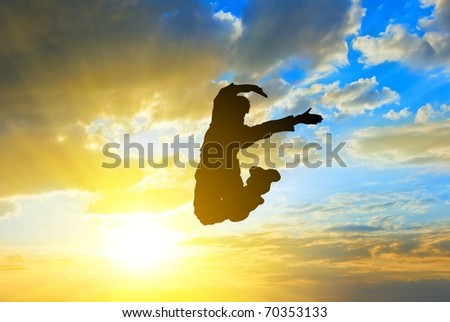people jumping on a sunny sky background