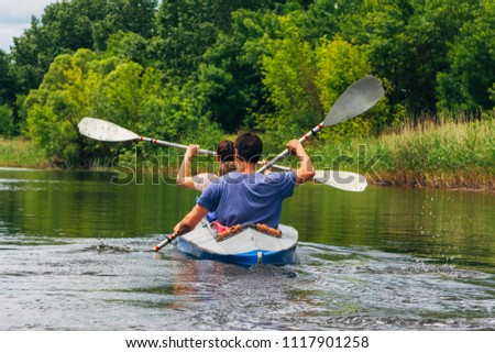 People kayaking on river at central Russia