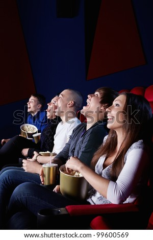 People laugh at the cinema - stock photo