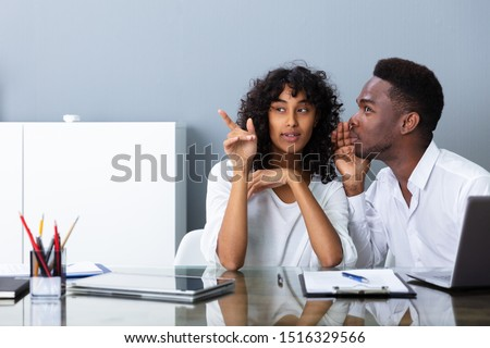 People Laughing About Their Coworker In Office