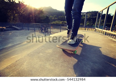 people legs practice skateboarding at skatepark #544132984