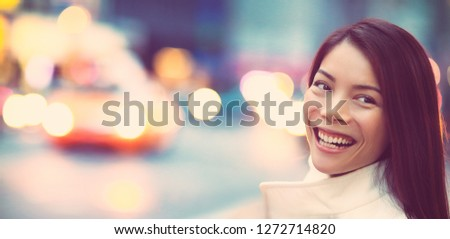 People lifestyle young woman happy smiling in New York city background banner. Asian girl travel in NYC street with taxis traffic.