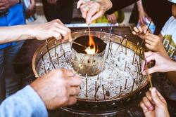 People light incense sticks for praying at the Todai-ji temple in Nara, Japan