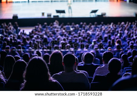 People listen to the speaker on the forum in the conference room. Blue lighting Stock photo ©