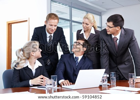 People look at an employee in the office