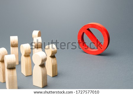 People look at red prohibition sign NO. Restriction of rights and freedoms, legislative prohibition laws and rules. Taboo, rejection. Abolition of restrictive measures under society pressure. Foto stock ©