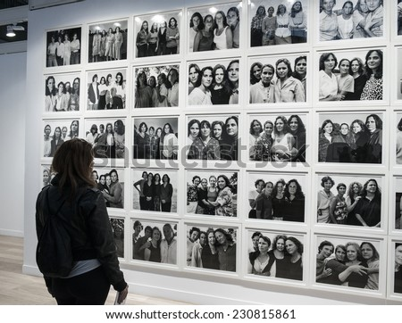 People looking at a photo of Nicholas Nixon at Paris Photo art fair 2014, Paris, France