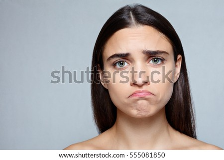 people, luxury and fashion, emotions concept - Portrait of young woman with shocked expression of sadness - Shutterstock ID 555081850
