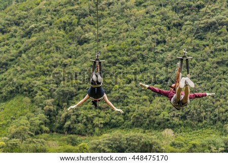 Shutterstock People making canopy, and extreme touristic activity hanged on wire at highs in Banos, Ecuador