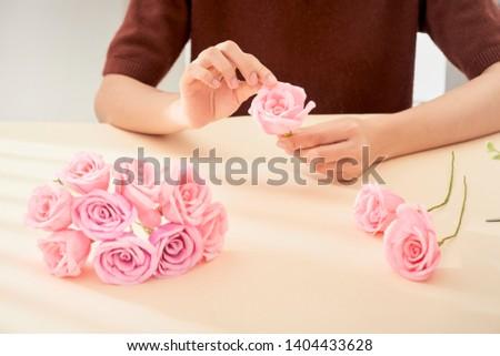 People making paper craft flower art  #1404433628