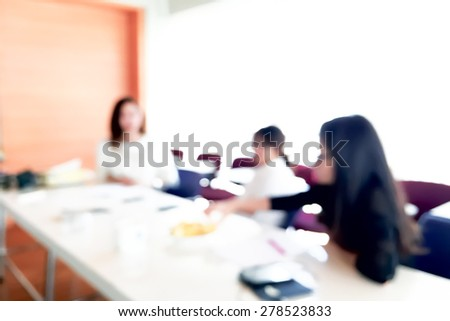 People meeting in office organization blur background with bokeh.