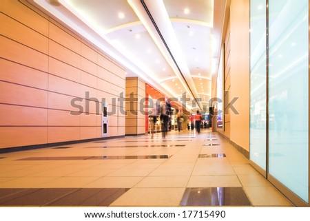 People mooving in hall corridor