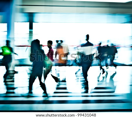 people moving in the office lobby deliberately blurred action,abstract image