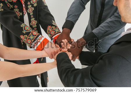 People of different nationalities and religions together.
