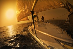 people on a sail boat at the sunset