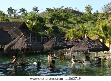 People on a tropical resort´s hot pool on a sunny summer afternoon (Pousada do Rio Quente/Brasil)