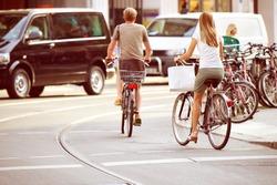 People on bikes in traffic