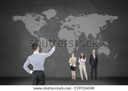 People on black with a map of the world behind them, good for worldwide and global business themes.