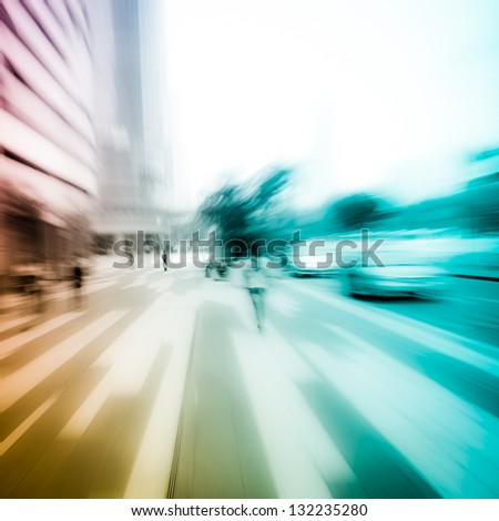 people on city street abstract blur