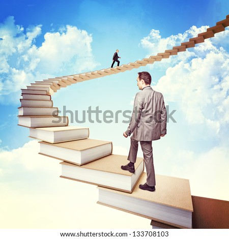 people on 3d books stair
