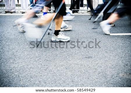 People on nordic walking race on city streets