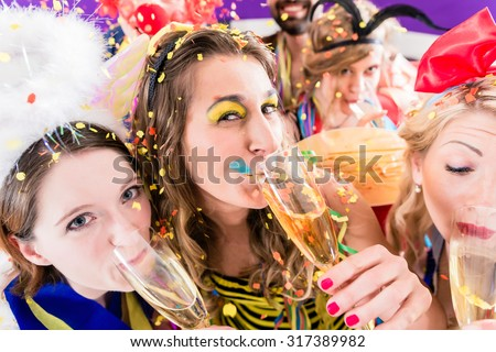 People on party drinking champagne and celebrating birthday or new years eve