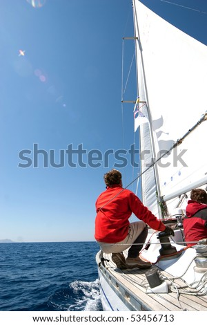 People on sailing boat on the sea