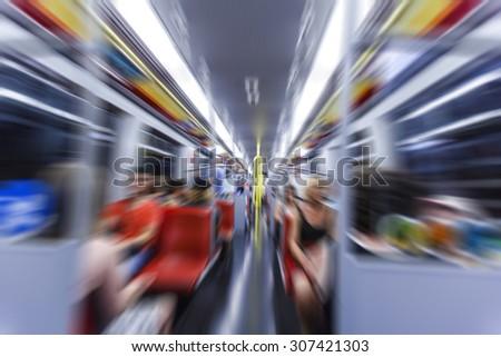 people on subway train , metro train  in rush hour ,blurred background