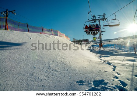 People on the chairlift - ski lift in polish mountains #554701282