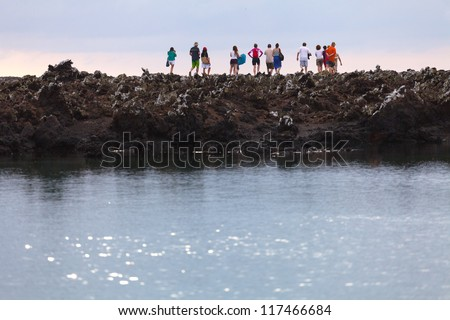 People on the coast, the Galapagos Islands, Ecuador