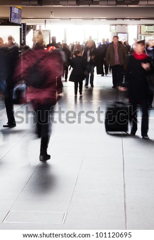 people on the move in the railway station