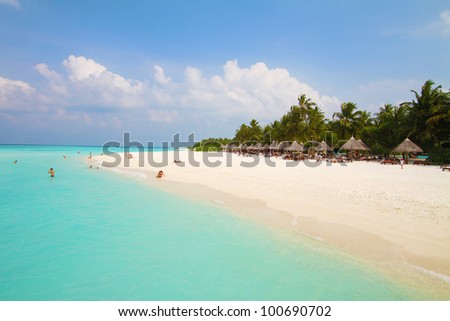 People on tropical beach. Maldives.