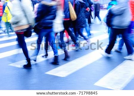 people on zebra crossing street